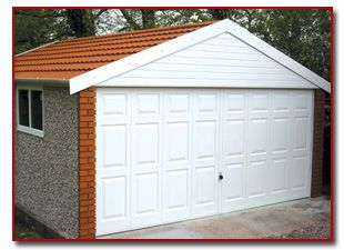 Large Pre Cast Concrete Garage With White Door